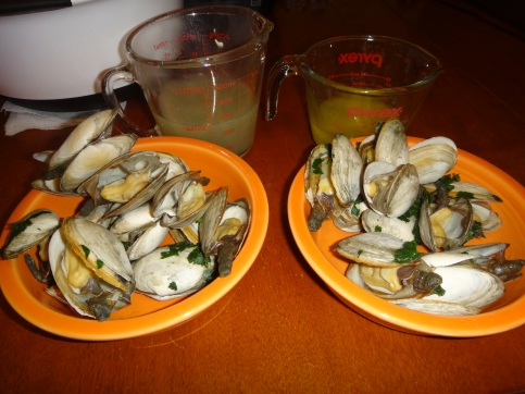 Steamers, clam broth, and melted butter