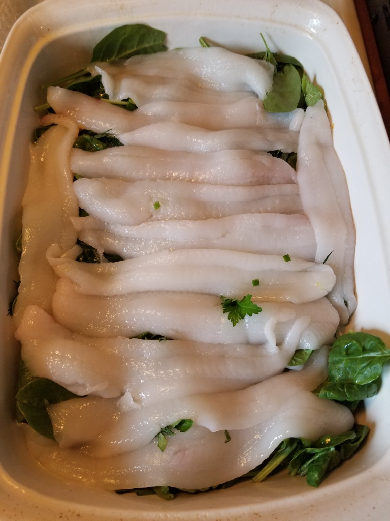 grey sole on bed of spinach